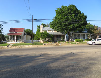 Three Sunday Houses in a row. Metzger is on the right. Note the street. This is not an optical illusion. Many of the streets in Fredericksburg are VERY wide. Built to allow a stagecoach to easily make a u-turn.